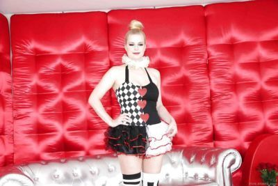 Perky blondie in snazzy cosplay outfit showcasing her ass and love holes