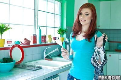 Redhead teen babe Sasha Pain stripping and toying her pussy in the kitchen