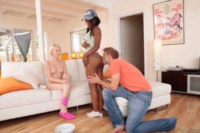 Ebony cutie and her lusty blonde girlfriend take part in a group sex action