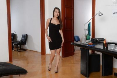 Slender Asian babe Sharon Lee posing fully clothed in tight black dress