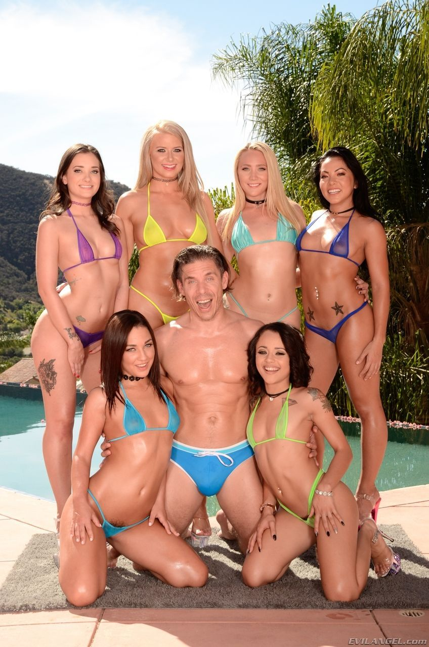 A group of hot chicks in bikinis model beside pool with 1 lucky sob