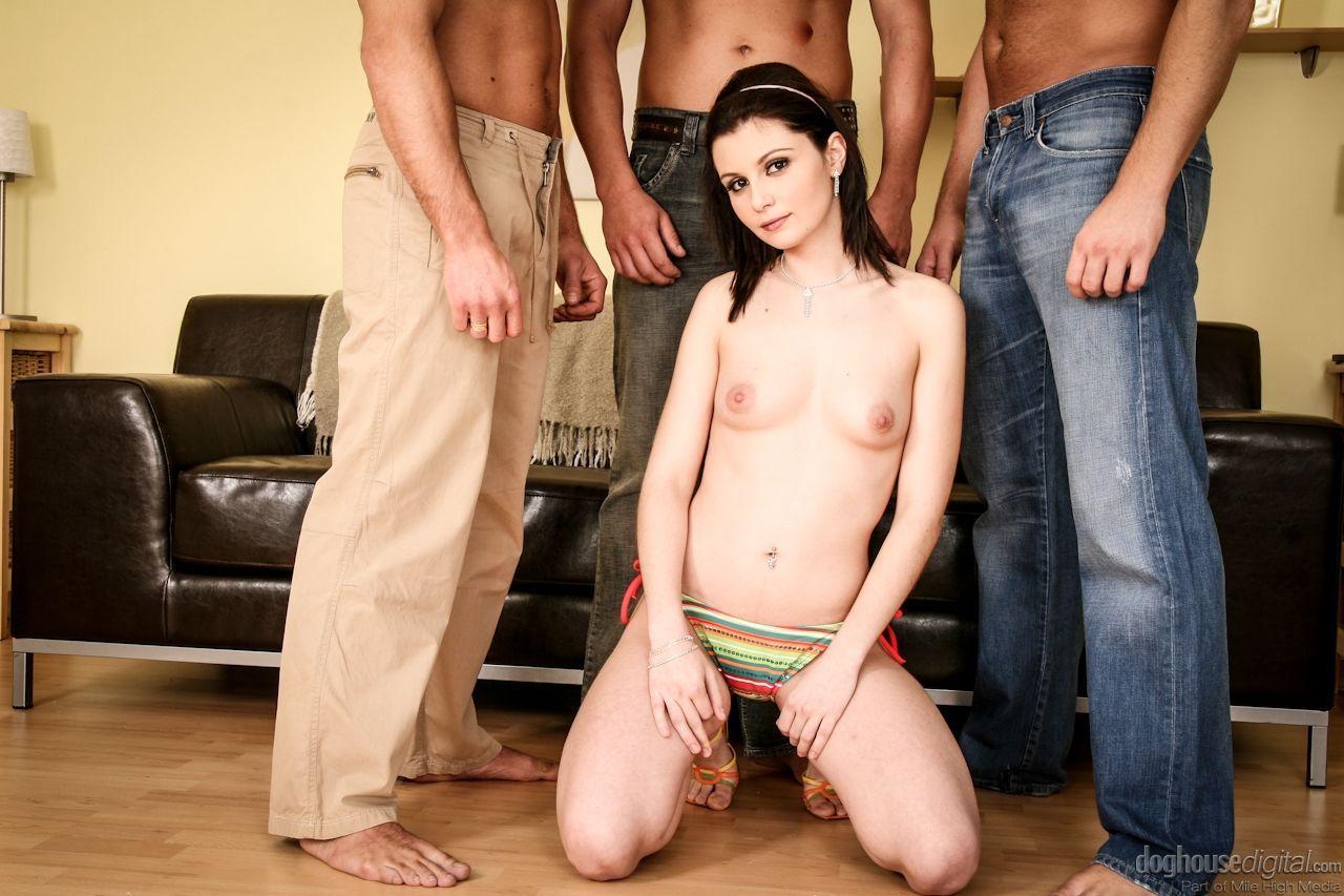 Brunette girl strips off shorts and bikini to suck off a group of guys