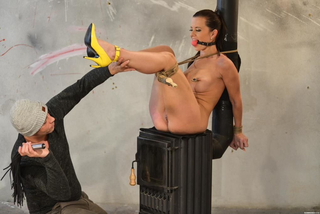 Tied up and ball gagged Cindy Dollar undergoes forced masturbation