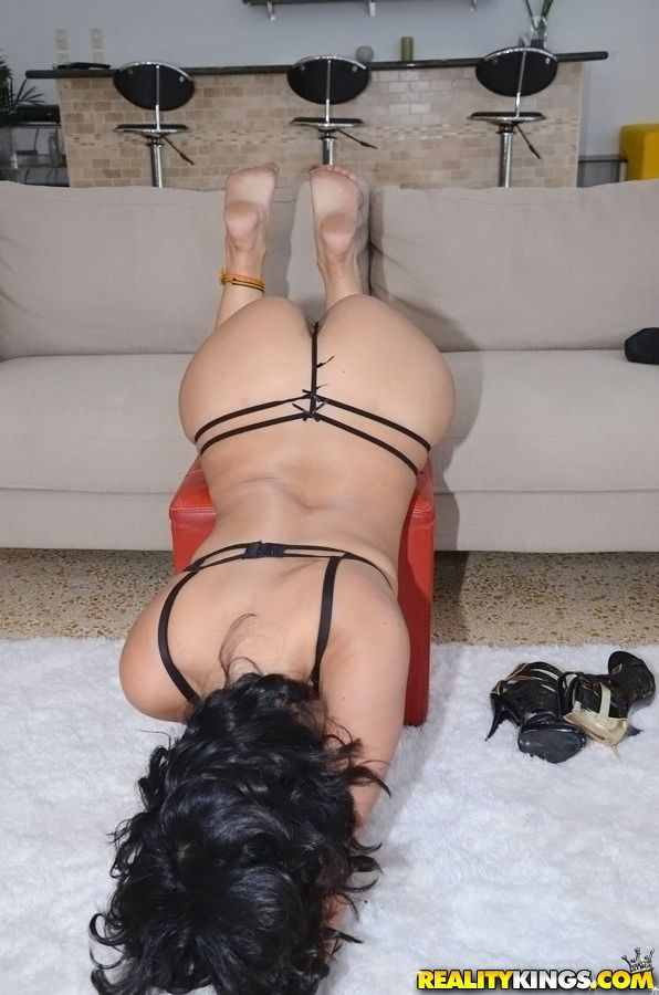 Playful brunette with curvy body undressing and posing in sexy lingerie