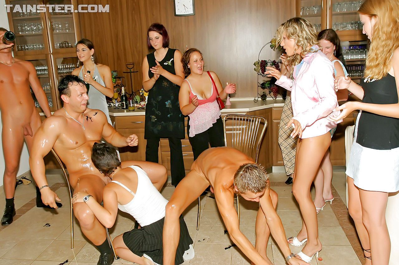 Hot women in stockings and high heels suck cock in CFNM groupsex party