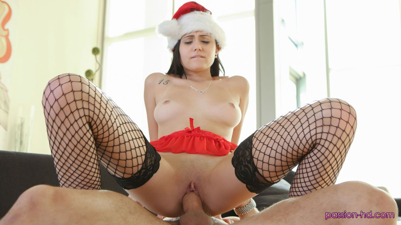 Dark haired female Ariana Marie takes a cumshot on her face for her Xmas gift