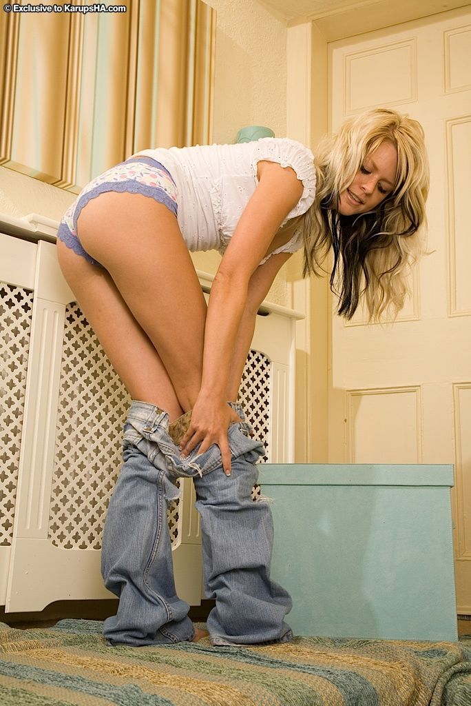 Blonde amateur Theo sliding blue jeans down to bare nice tight ass