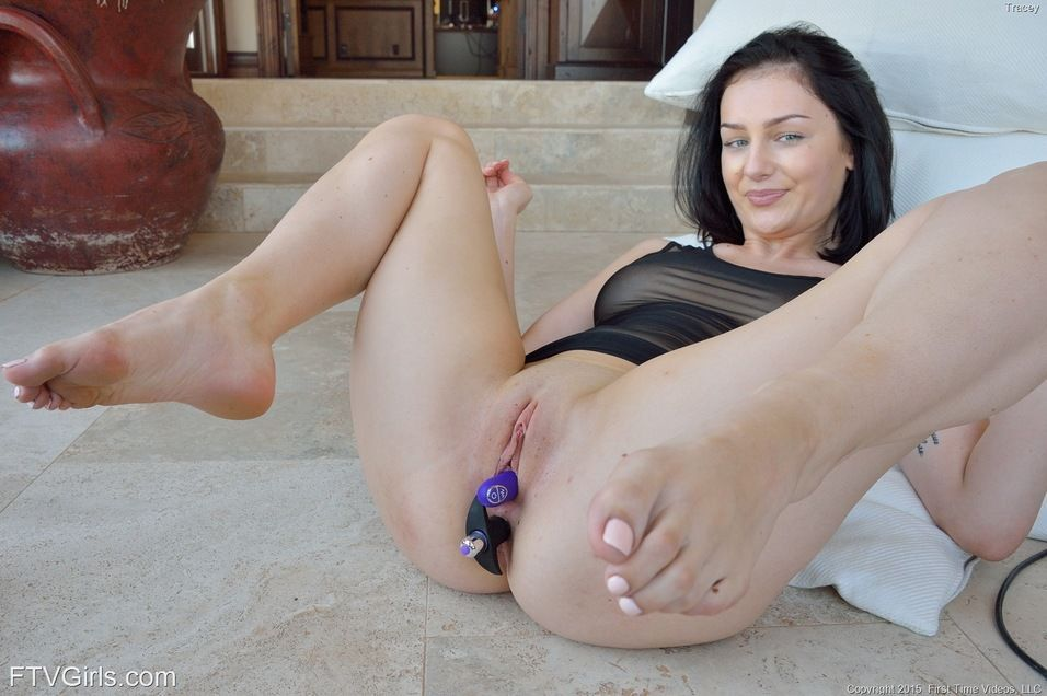 Sexy brunette spreads bare legs for anal and vaginal sex toy insertions