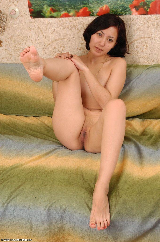 Amateur brunette Elena sliding panties over tight Asian ass and bare legs