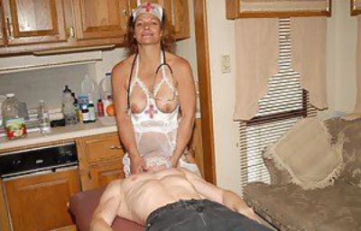 Slutty granny nurse Ivee jerking off husbands cock in kitchen