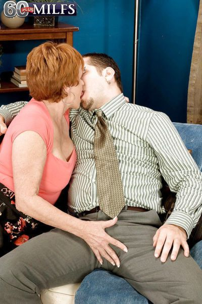 Redhead granny Valerie instructing a younger man on finer points of hard sex