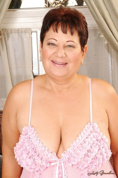Fatty short haired granny on high heels stripping off her lingerie