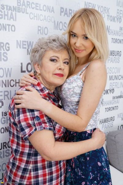 Naughty granny seduces a young girl for her first lesbian experience