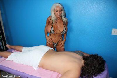 Big boobed granny Sally Dangelo jerks a dick until the sperm flows
