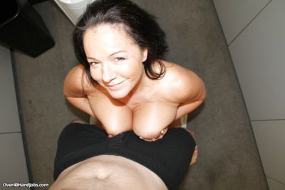 Saucy brunette mom pleasing a hard dick with her hands- big tits and tongue