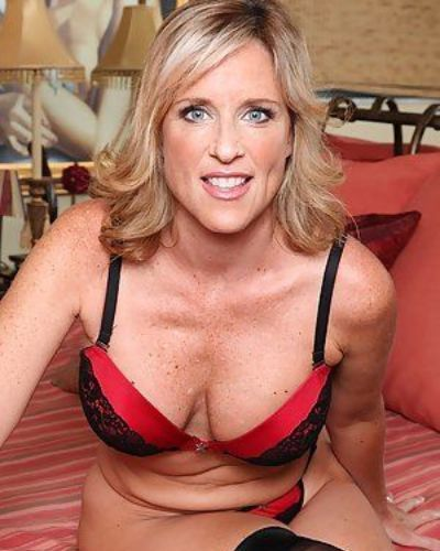 Aged broad Jodi West loosing big boobs before masturbating in stockings