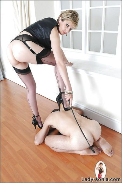 Barely clothed femdom in stockings has some fun with her male pet - part 2