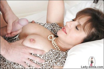 Lusty handcuffed mature woman gets a huge cumshot on her big tits - part 2