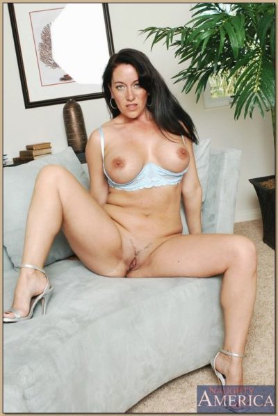 Mature brunette Sandy Beach flashing hooters and spreading shaved slit - part 2