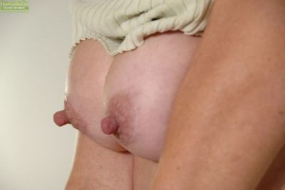 Blonde milf takes off her panties while playing with her big tits - part 2