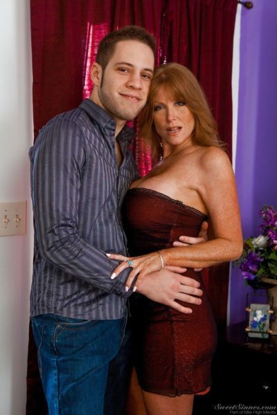 Ravishing mature bombshell with big tits Darla makes out with her man