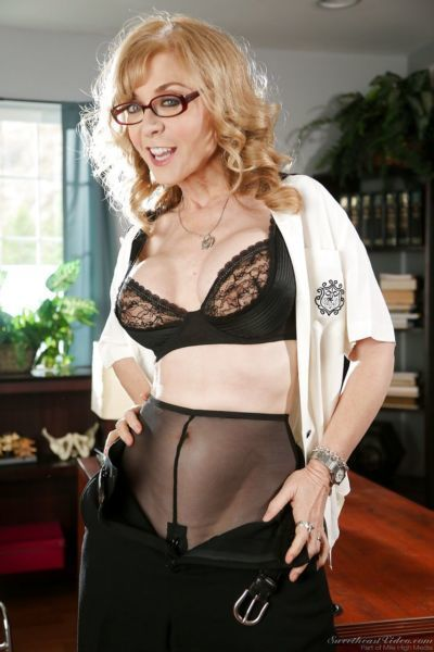 Mature slut Nina Hartley & young Sara Luvv have strapon sex at the office