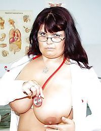 Fatty mature nurse with huge boobs masturbating her twat with a dildo