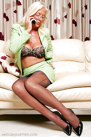 Horny mature vixen in stockings stripping and caressing herself