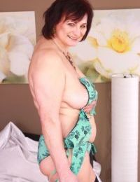 Mature plumper wets her vibrator before inserting it into her shaved vagina