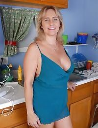 Chubby older woman Wanda strips and plays with kitchen utensils