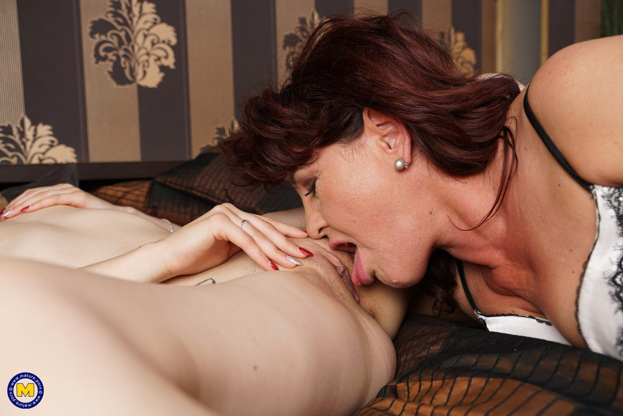 Older and younger lesbians kiss before undressing for oral sex exchange