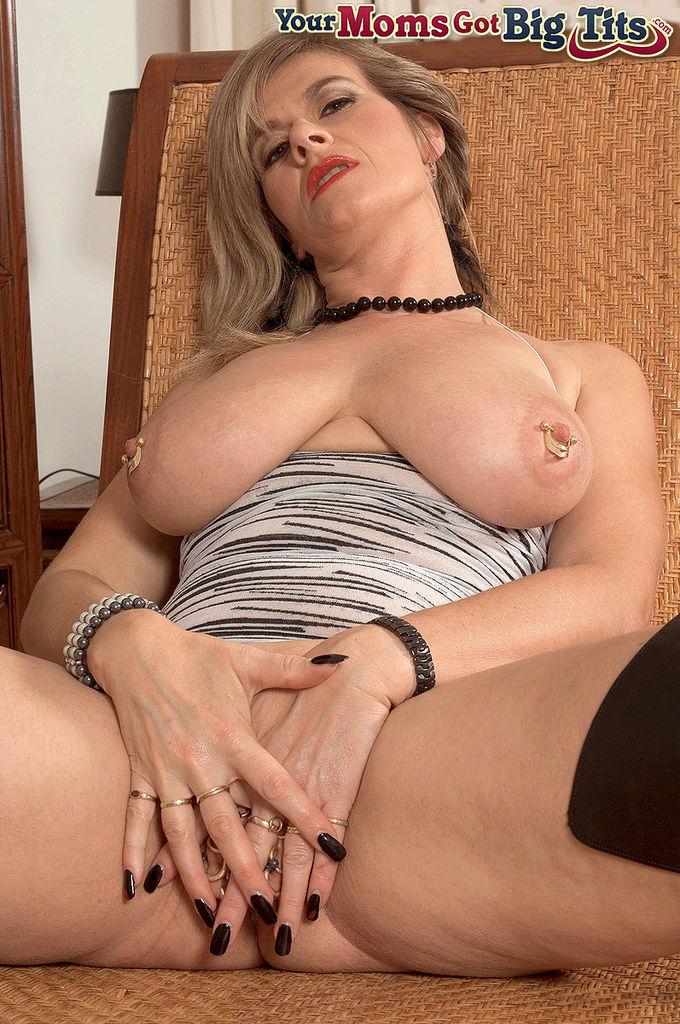 European mature pornstar Marina Rene shows her huge boobs and pierced snatch