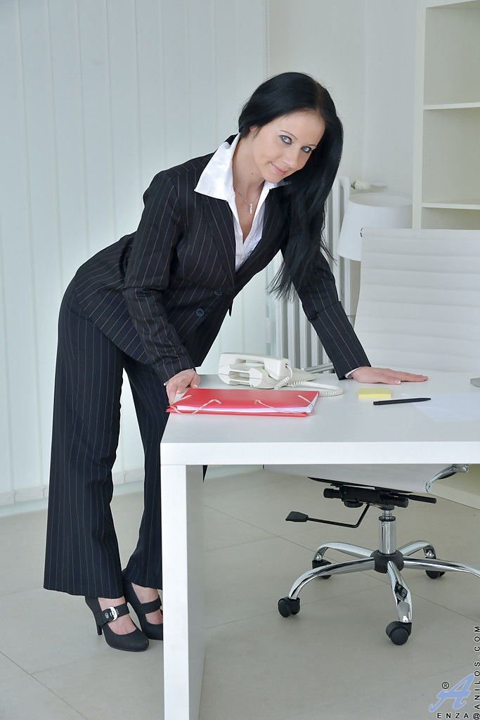 Mature boss lady Enza removing business suit to pose nude at work