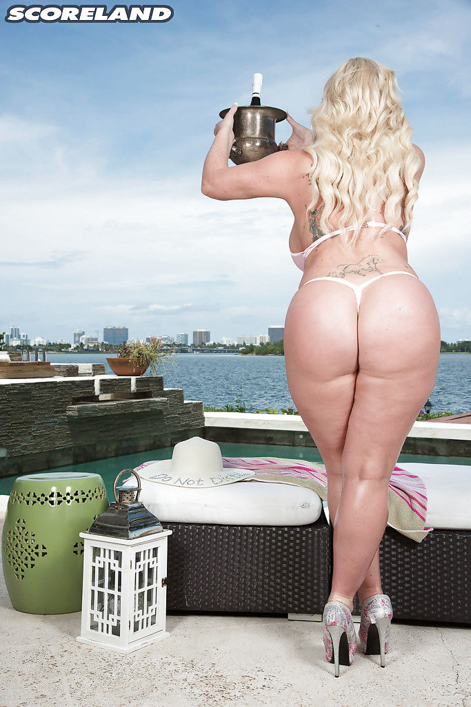 Chunky blonde Holly Wood showing off big ass and tits overlooking harbor
