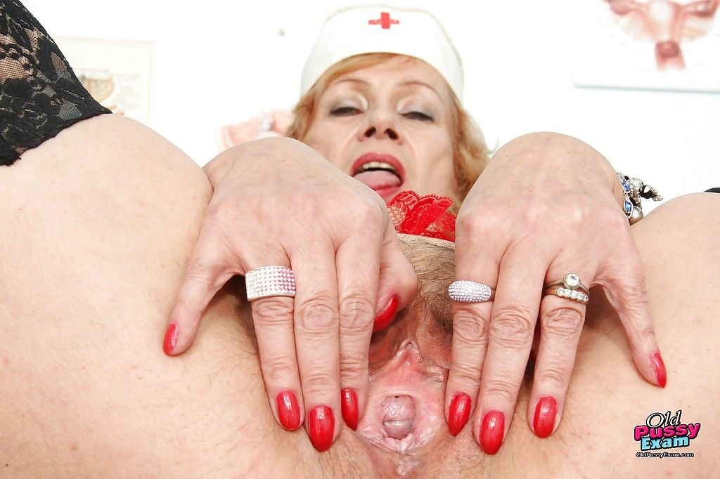 Naughty granny in black stockings playing with a huge jelly toy
