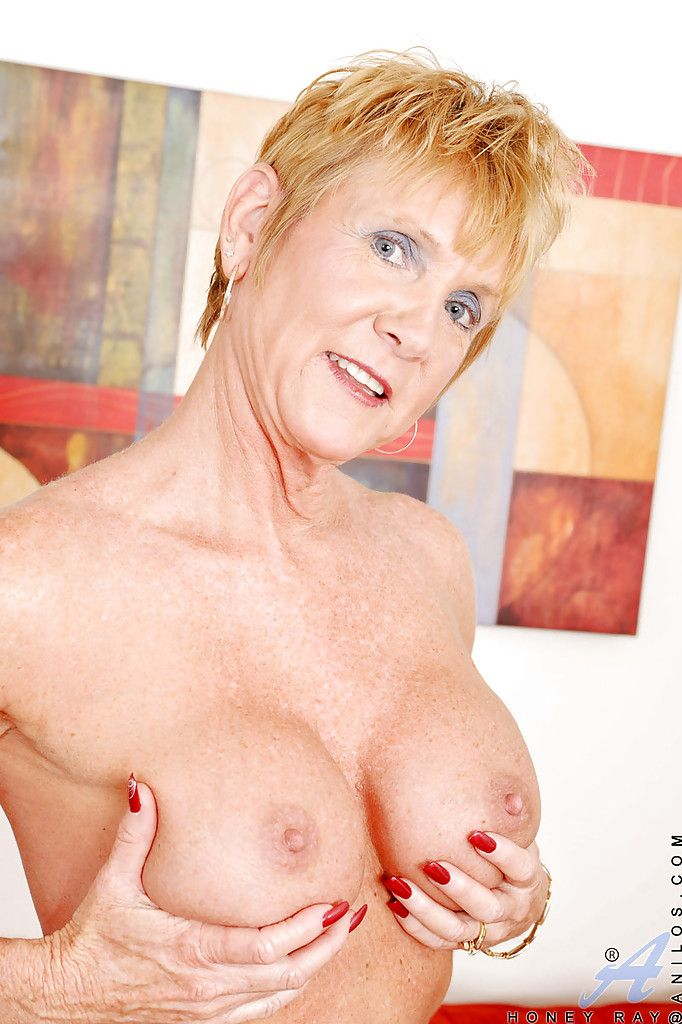 Busty granny Honey Ray strips off underwear and toys her shaved cunt