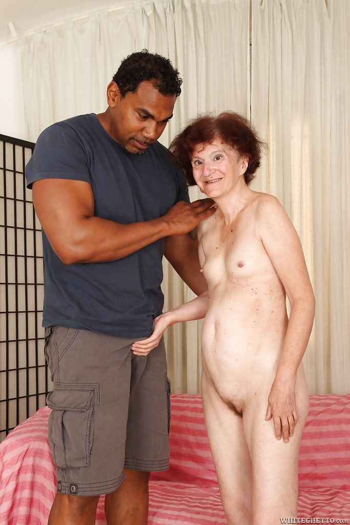 Black man is fucking slutty redhead Marcelina in her shaved pussy