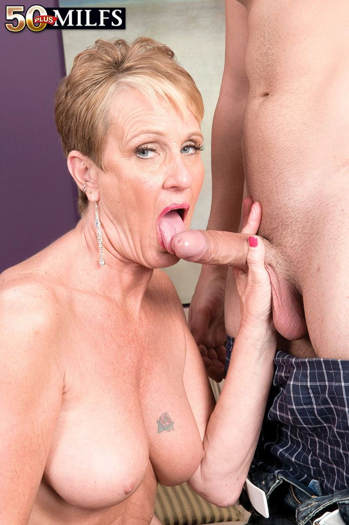 Mature lady with short hair Misty Luv shows young guy a thing or two about sex