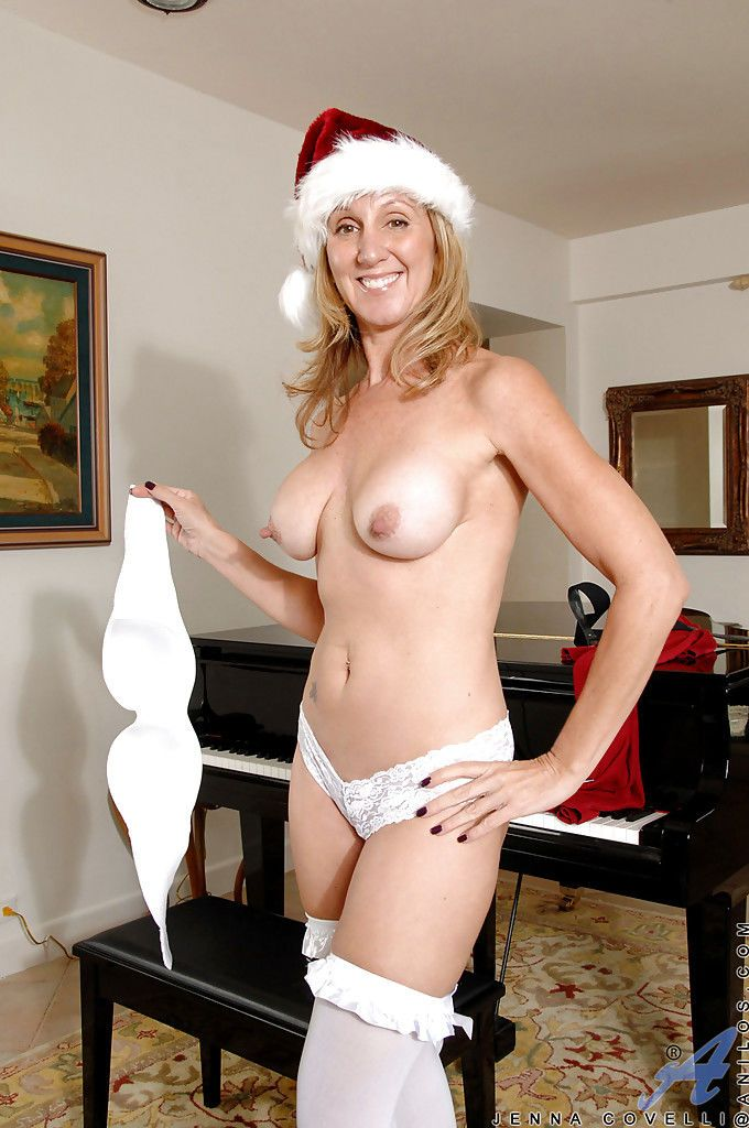 Juggy mature blonde gets rid of her Christmas outfit and white lingerie - part 2