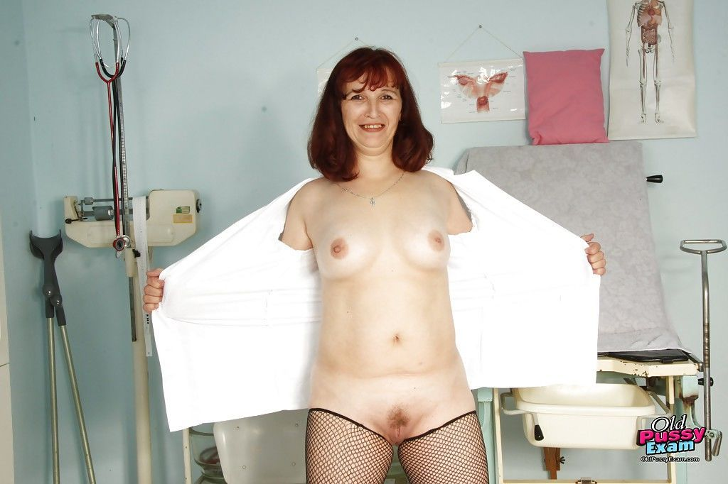 Nasty mature lady in stockings stuffing her twat with gyno tools
