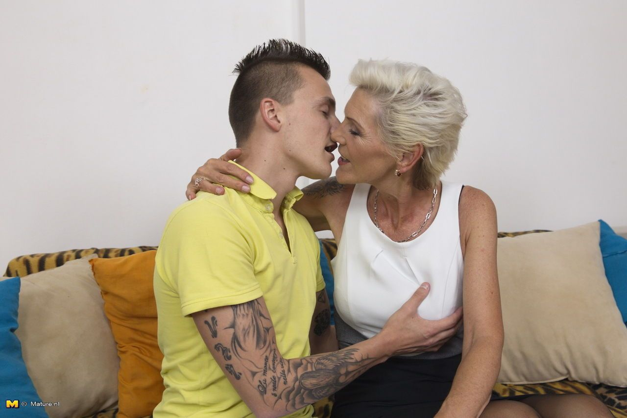 Mature housewife welcomes her younger daytime lover with a tongue kiss