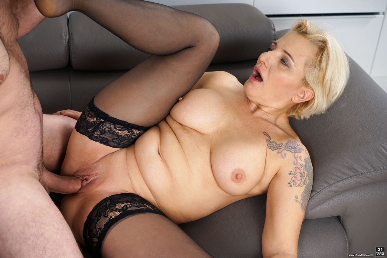Older blonde lady Maria Jamma strips to black stockings before getting banged
