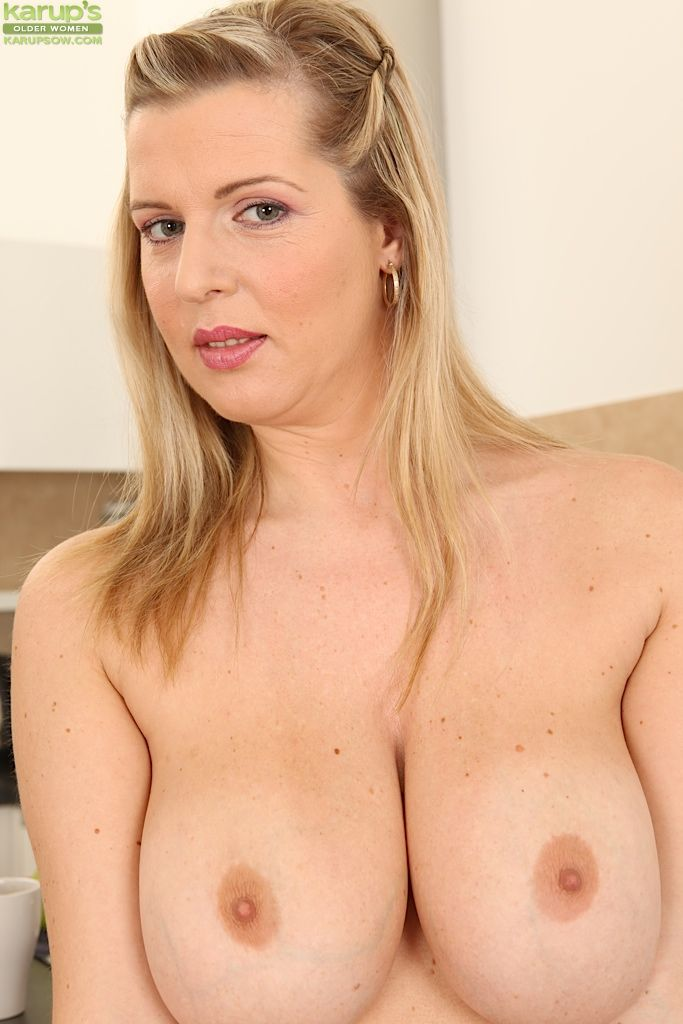 Busty mature woman Britney flashes her nice all natural set of tits
