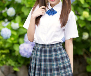 Cutie Japanese schoolgirl in pigtails shows naked ass in..