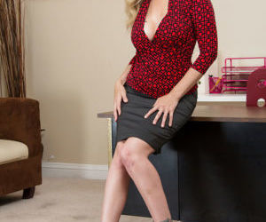 Tempting blonde office lady getting nude and teasing her..