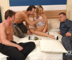 Sexy MILF Cherry Jul plays spin the bottle with 3 men on..