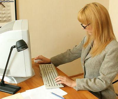 Bosomy office blonde with slim..