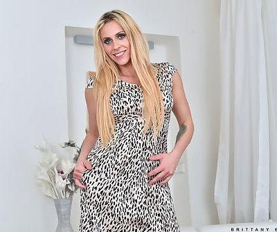 Attractive blonde slut strips and..
