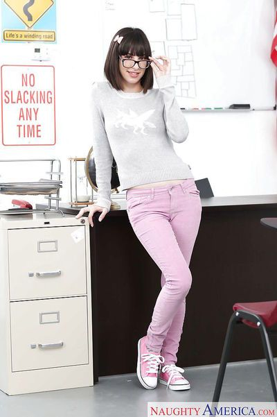 Glasses wearing coed Nora Doll flashing tiny tits in jeans and socks