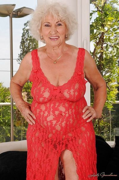 Naughty granny with massive flabby tits stripping off her sheer dress